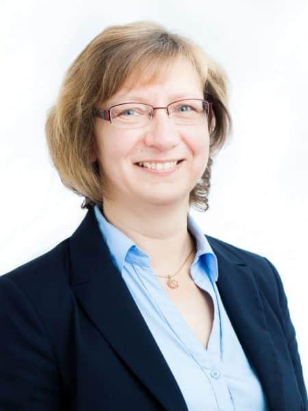 Heike Vocke Geschäftsführerin bei iSAX gratuliert DUALIS zum Jubiläum